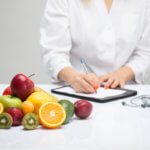 nutritionist noting healthy fruits