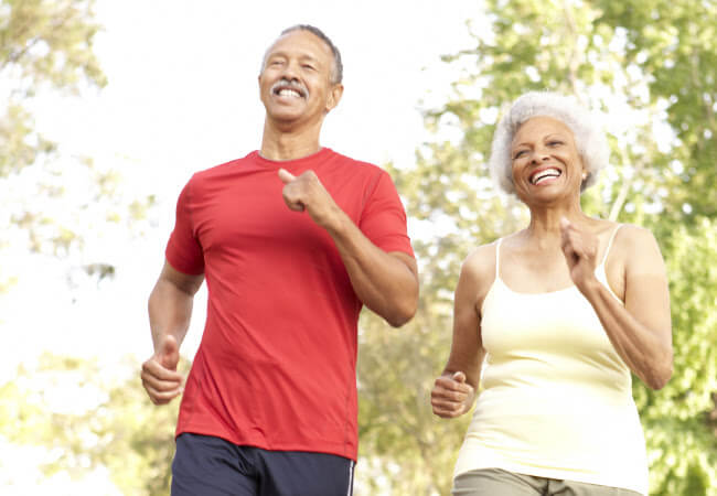 Couple walking after finding effective knee and hip pain relief